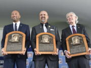 Hall of Fame inductees, from left, Derek Jeter, Larry Walker and Ted Simmons hold their plaques for photos after the induction ceremony at Clark Sports Center on Wednesday, Sept. 8, 2021, at the National Baseball Hall of Fame in Cooperstown, N.Y.