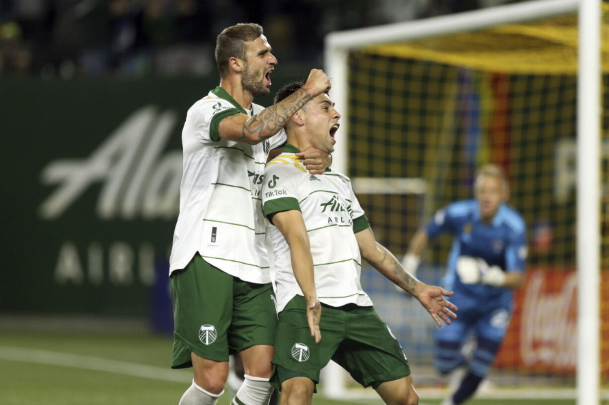 Portland Timbers forward Felipe Mora, front right, celebrates his second-half goal against the Colorado Rapids during an MLS soccer match Wednesday, Sept. 15, 2021, in Portland, Ore.