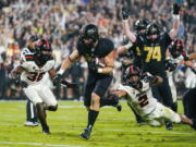 Purdue running back Zander Horvath (40) runs past Oregon State linebacker Andrzej Hughes-Murray (2) for a touchdown during the first half of an NCAA college football game in West Lafayette, Ind., Saturday, Sept. 4, 2021.