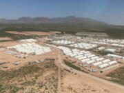 A aerial view of an area of Fort Bliss Army base in Texas is seen Friday, Sept. 10, 2021. The Biden administration provided the first public look inside the U.S. military base where Afghans airlifted out of Afghanistan are screened, amid questions about how the government is caring for the refugees and vetting them.