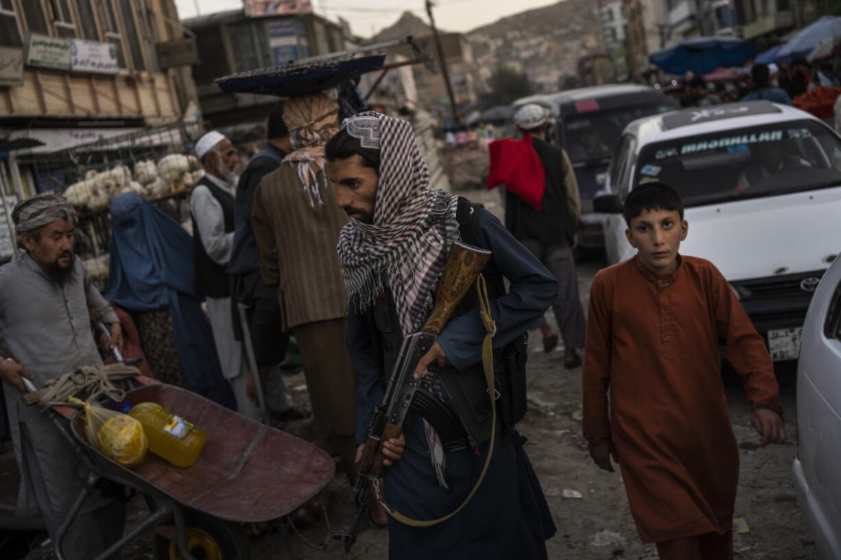 Taliban fighters patrol a market in Kabul's Old City, Afghanistan, Tuesday, Sept. 14, 2021. A month after the fall of Kabul, the question of how the world will get aid to citizens without enriching Afghanistan's Taliban rulers is haunting the country. The stakes have soared for Afghans, who along with the threat of famine and a collapsing health care system face a looming crisis as winter approaches.