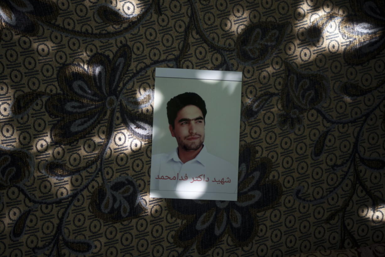 A portrait of Fida Mohammad, a 24-year-old dentist, who died after falling from a departing U.S. Air Force C-17 on Aug. 16, hangs in his family house in Kabul, Afghanistan, Friday, Sept. 17, 2021.