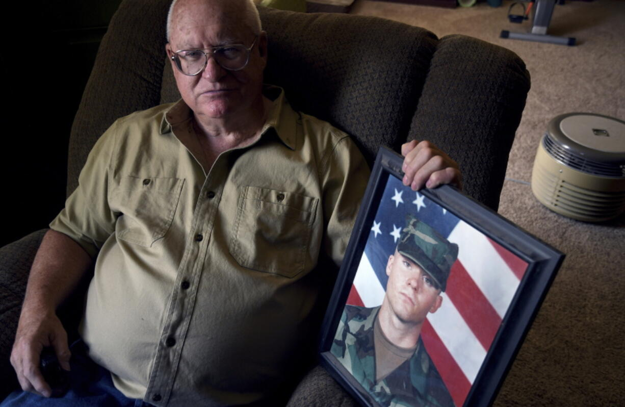 Donn Edmunds, a 25-year U.S. Army veteran who served in Vietnam, sits for a portrait in his living room in Cheyenne, Wyo., Wednesday, Sept. 1, 2021. Edmunds' son, Army Ranger Spc. Jonn Edmunds, and another soldier died when a Black Hawk helicopter on a search-and-rescue mission crashed in Pakistan in October 2001. They were among the first U.S. casualties in the Afghanistan war.