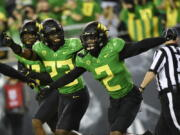 Oregon cornerback Mykael Wright (2) celebrates his interception with Oregon safety Verone McKinley III (23) during the first quarter of an NCAA college football game Saturday, Sept. 25, 2021, in Eugene, Ore.