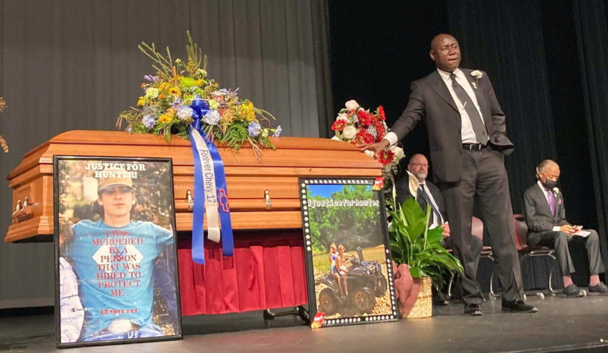 FILE - Attorney Ben Crump stands next to Hunter Brittain's casket at the Beebe High School Auditorium before his memorial service in Beebe, Ark., on Tuesday, July 6, 2021. Brittain was shot and killed by a Lonoke County Sheriff's deputy during a traffic stop June 23.