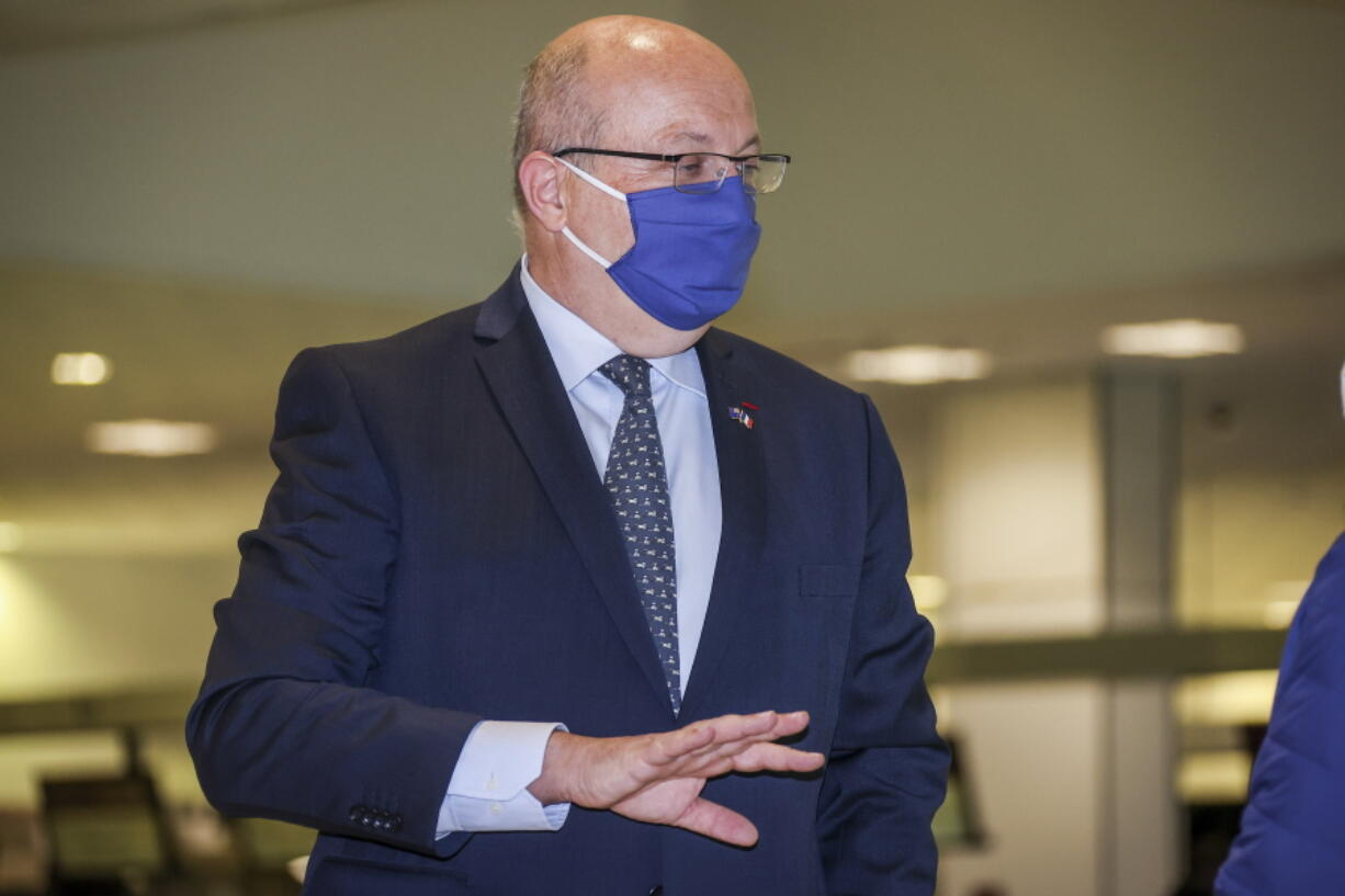 """France's Ambassador to Australia Jean-Pierre Thebault gestures as he arrives at Sydney Airport, Saturday Sept. 18, 2021. Thebault has described as a """"huge mistake"""" Australia's surprise cancellation of a major submarine contract in favor of a U.S. deal, in an unprecedented show of anger among the allies."""