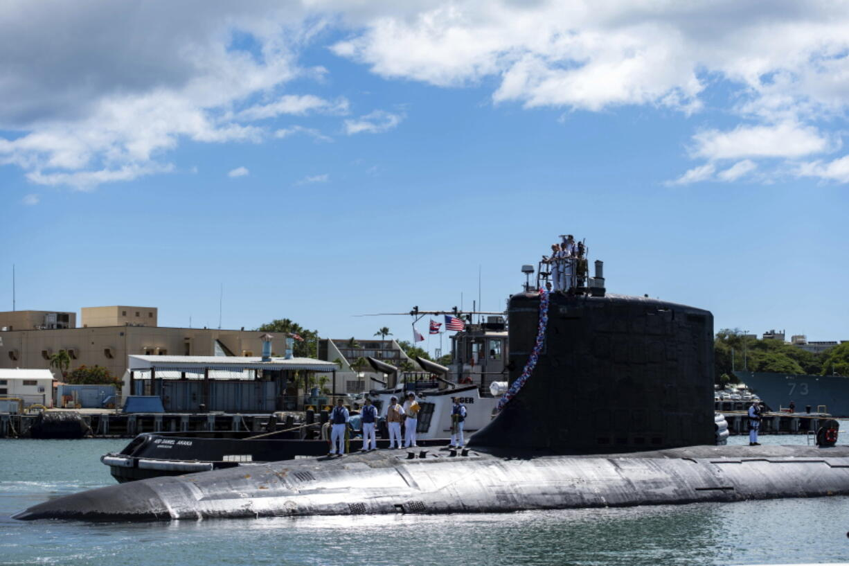 The Virginia-class fast-attack submarine USS Illinois returns home to Joint Base Pearl Harbor-Hickam from a deployment on Sept. 13. Australia has decided to invest in U.S. nuclear-powered submarines and dump its contract with France to build diesel-electric submarines. (u.s.