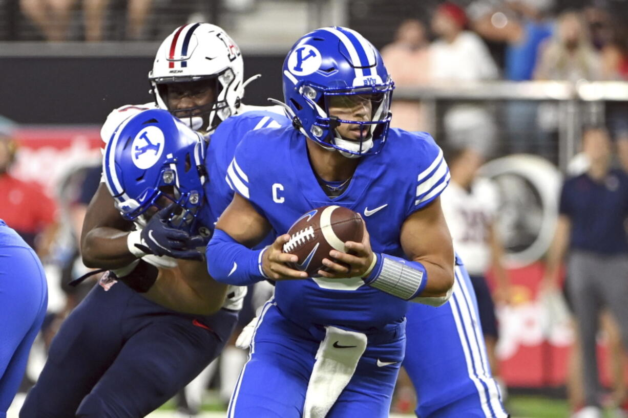BYU quarterback Jaren Hall looks to hand off the ball against Arizona during the second half of an NCAA college football game Saturday, Sept. 4, 2021, in Las Vegas.