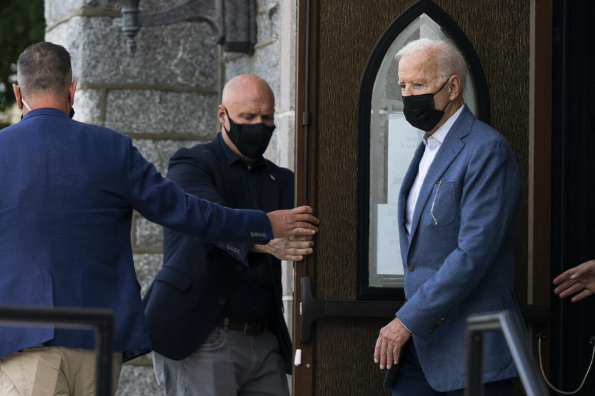President Joe Biden leaves St. Edmund Roman Catholic Church in Rehoboth Beach, Del., after attending a Mass, Saturday, Sept. 18, 2021. Biden is spending the weekend at his Rehoboth Beach home.