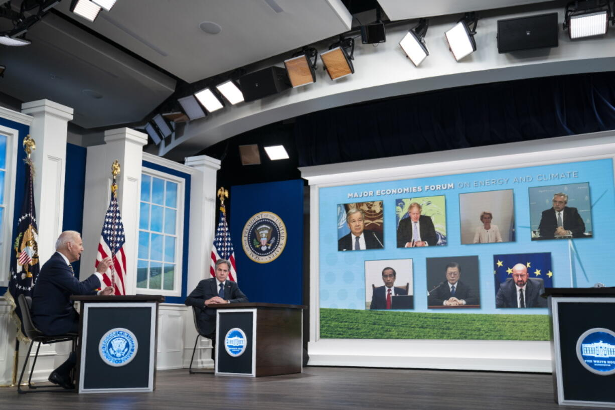 Secretary of State Antony Blinken listens as President Joe Biden delivers remarks to the Major Economies Forum on Energy and Climate, in the South Court Auditorium on the White House campus, Friday, Sept. 17, 2021, in Washington.