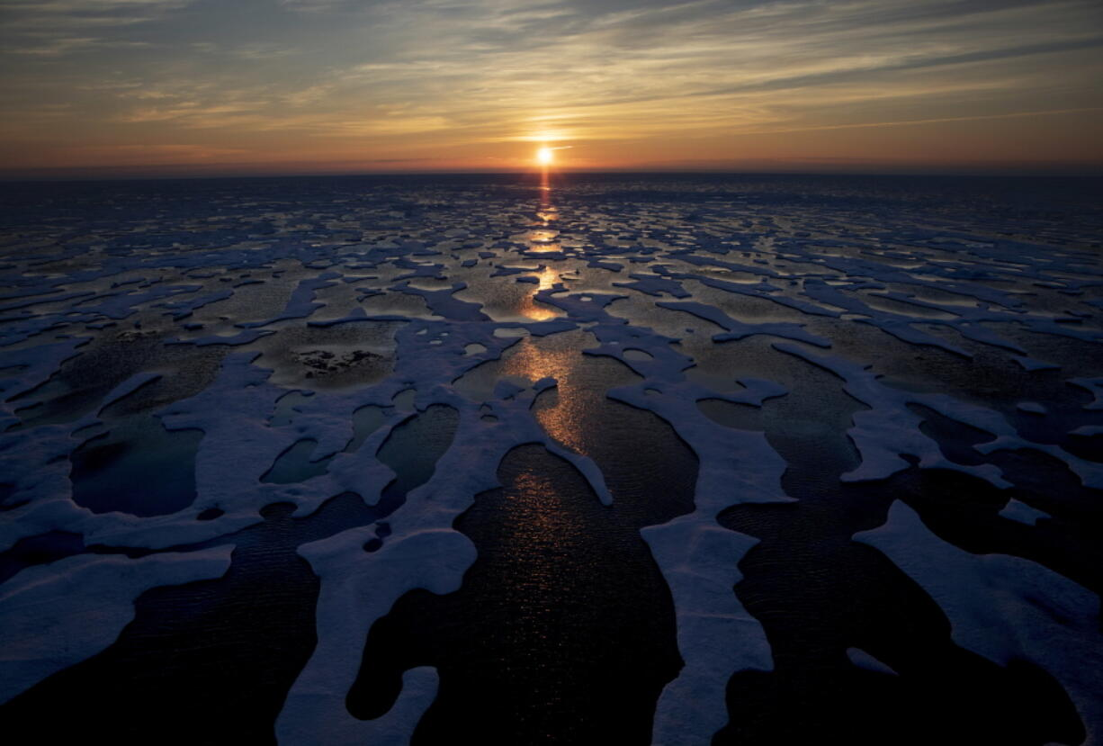FILE - In this July 22, 2017, file photo the midnight sun shines across sea ice along the Northwest Passage in the Canadian Arctic Archipelago. The Biden administration is stepping up its work to figure about what to do about the thawing Arctic, which is warming three times faster than the rest of the world. The White House said Friday, Sept. 24, 2021, that it is reactivating the Arctic Executive Steering Committee, which coordinates domestic regulations and works with other Arctic nations. It also is adding six new members to the U.S. Arctic Research Commission, including two indigenous Alaskans.