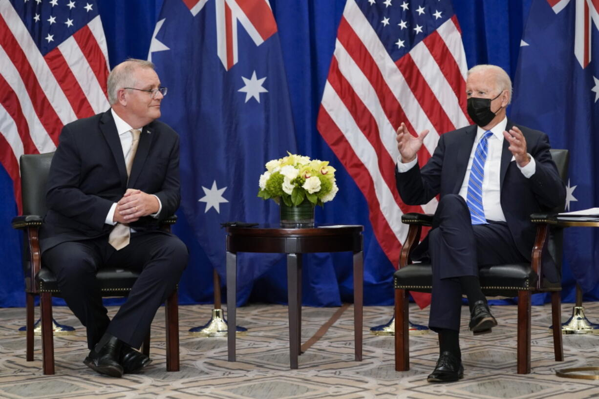 """FILE - In this Sept. 21, 2021, file photo President Joe Biden meets with Australian Prime Minister Scott Morrison at the Intercontinental Barclay Hotel during the United Nations General Assembly in New York. Biden is set to host the first ever in-person gathering of leaders of the Indo-Pacific alliance known as """"the Quad"""" on Friday, wrapping up a tough week of diplomacy in which he faced no shortage of criticism from both allies and adversaries."""