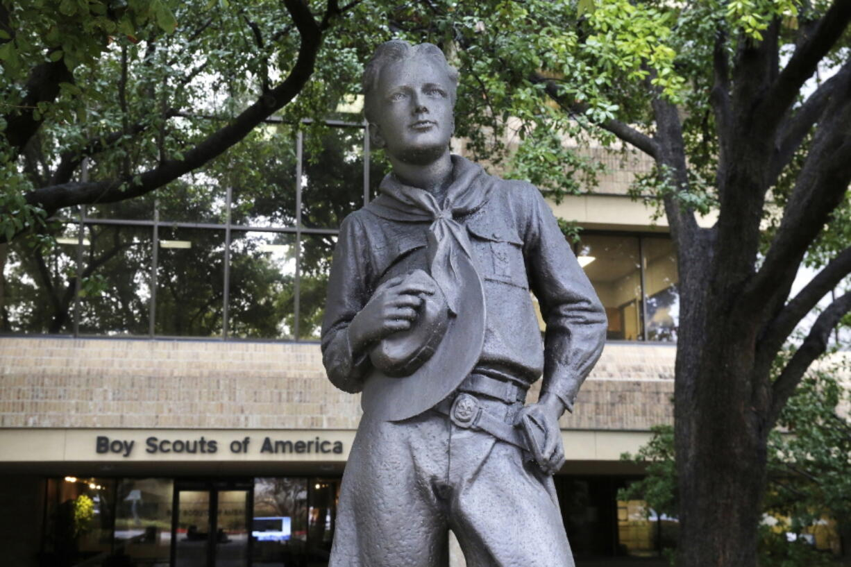 FILE - In this Feb. 12, 2020, file photo, a statue stands outside the Boy Scouts of America headquarters in Irving, Texas. One of the primary insurers of the Boy Scouts of America announced Tuesday, Sept. 14, 2021, that it has reached a tentative settlement agreement with the organization and with attorneys representing tens of thousands of men who say they were molested as youngsters decades ago by scoutmasters and others.