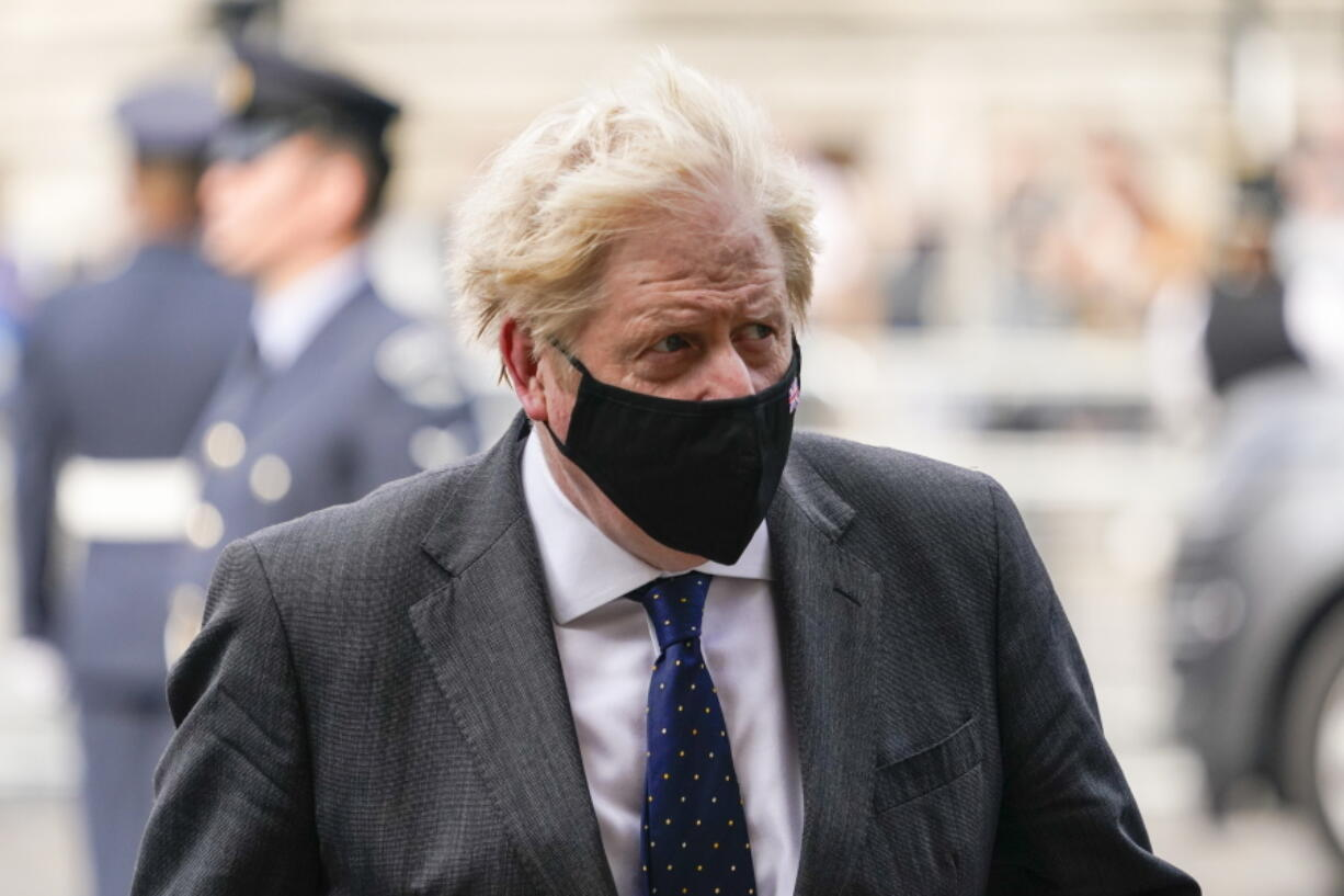 Britain's Prime Minister Boris Johnson arrives for a service to mark the 81st Anniversary of the Battle of Britain at Westminster Abbey, in London Sunday Sept. 19, 2021.