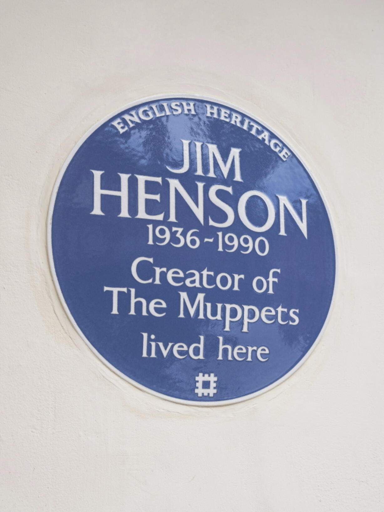 In this undated photo provided by English Heritage a view of the blue plaque on the former London home of Jim Henson, creator of The Muppets, who has been honoured with a blue plaque.  The American creator of the Muppets was honored Tuesday, Sept, 7, 2021 in Britain with a blue plaque at his former home in north London, which he bought after 'The Muppet Show' was commissioned for British television -- 50 Downshire Hill in Hampstead in north London to be precise.