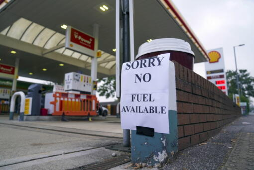 A view of a sign at a petrol station, in Bracknell England, Sunday Sept. 26, 2021. In a U-turn, Britain says it will issue thousands of emergency visas to foreign truck drivers to help fix supply-chain problems that have caused empty supermarket shelves, long lines at gas stations and shuttered petrol pumps.