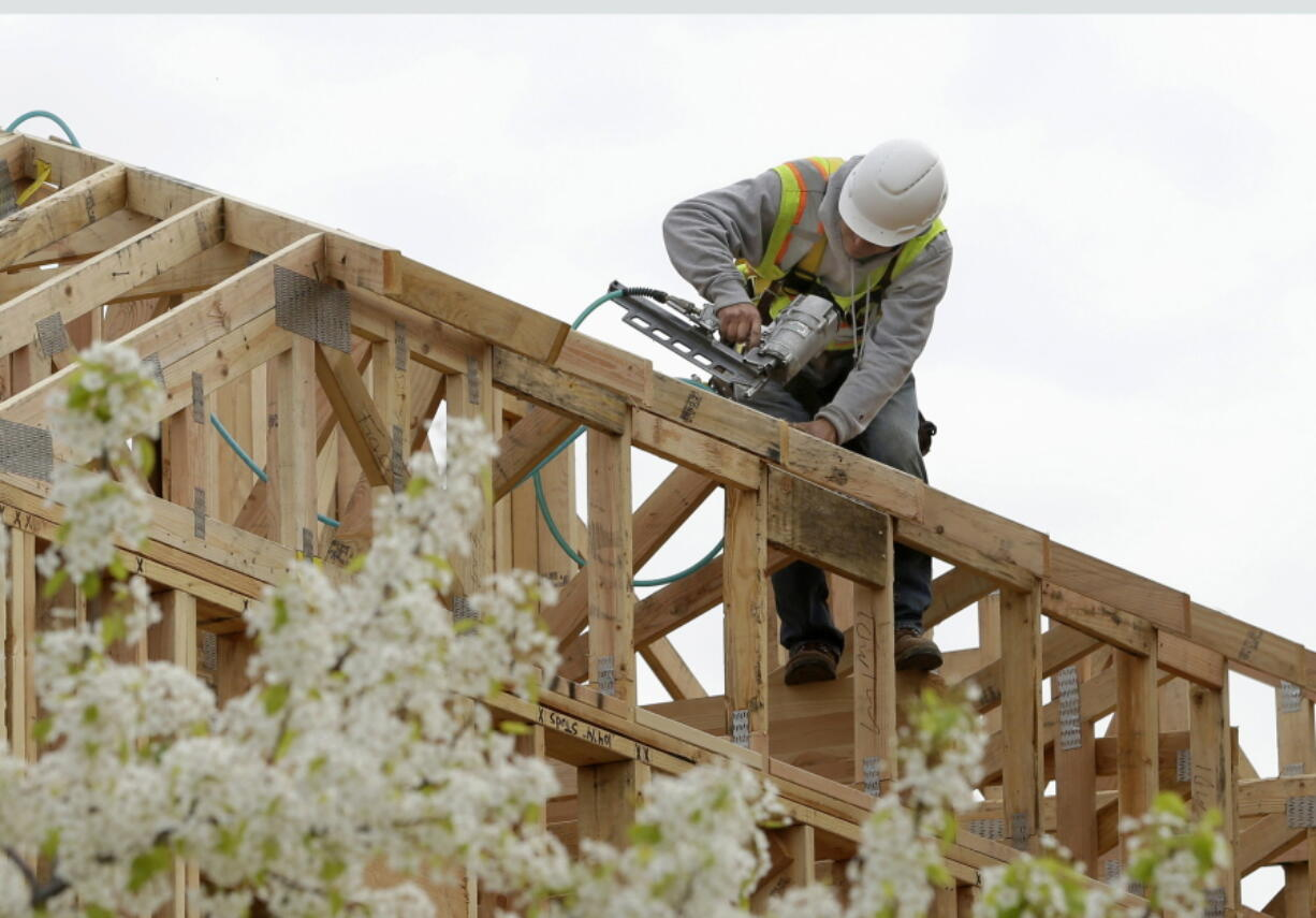 FILE - In this Feb. 8, 2019 file photo, work is done on an apartment building under construction in Sacramento, Calif. California lawmakers have advanced the second of two measure's designed to ease local zoning ordinances for home construction. Spurred by an affordable housing shortage, spiking home prices and intractable homelessness, California lawmakers on Thursday, Aug. 26, 2021,  advanced the second of two measures designed to cut through local zoning ordinances.