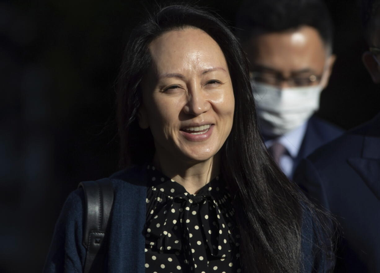 Meng Wanzhou, chief financial officer of Huawei, smiles as she leaves her home in Vancouver on Friday, Sept. 24, 2021.