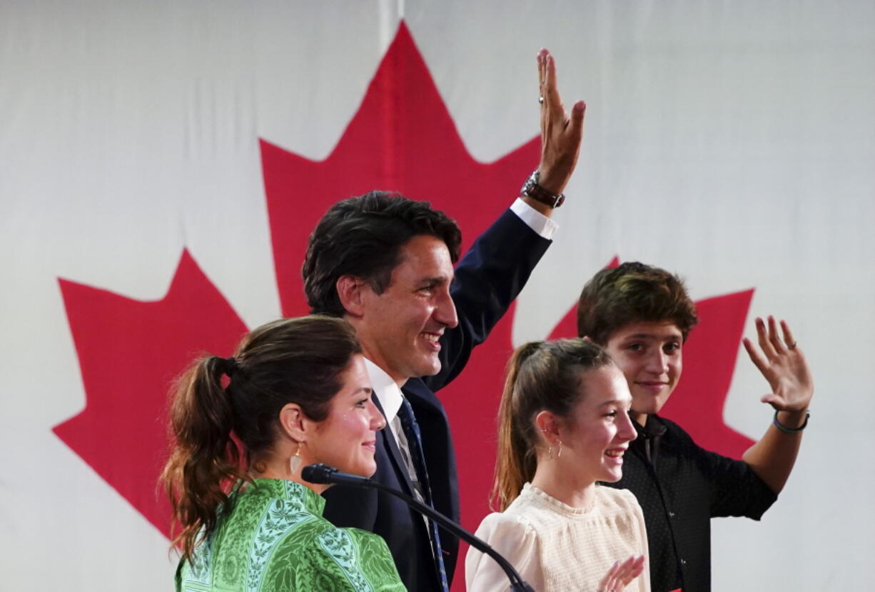 Prime Minister Justin Trudeau is joined on stage by wife Sophie Gregoire Trudeau, left, and children Xavier and Ella-Grace, during his victory speech at Party campaign headquarters in Montreal, early Tuesday, Sept. 21, 2021.