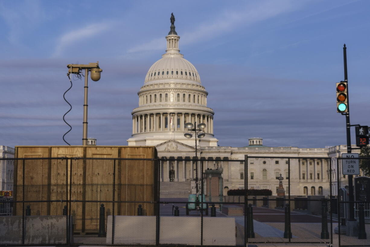 Security fencing and video surveillance equipment has been installed around the Capitol in Washington, Thursday, Sept. 16, 2021, ahead of a planned Sept. 18 rally by far-right supporters of former President Donald Trump who are demanding the release of rioters arrested in connection with the 6 January insurrection. (AP Photo/J.