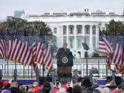 FILE - In this Jan. 6, 2021, file photo with the White House in the background, President Donald Trump speaks at a rally in Washington. The Biden administration will have a big say in whether the government releases information to Congress on the actions of former president Donald Trump and his aides on Jan. 6. But there could be a lengthy court battle before any details come out.