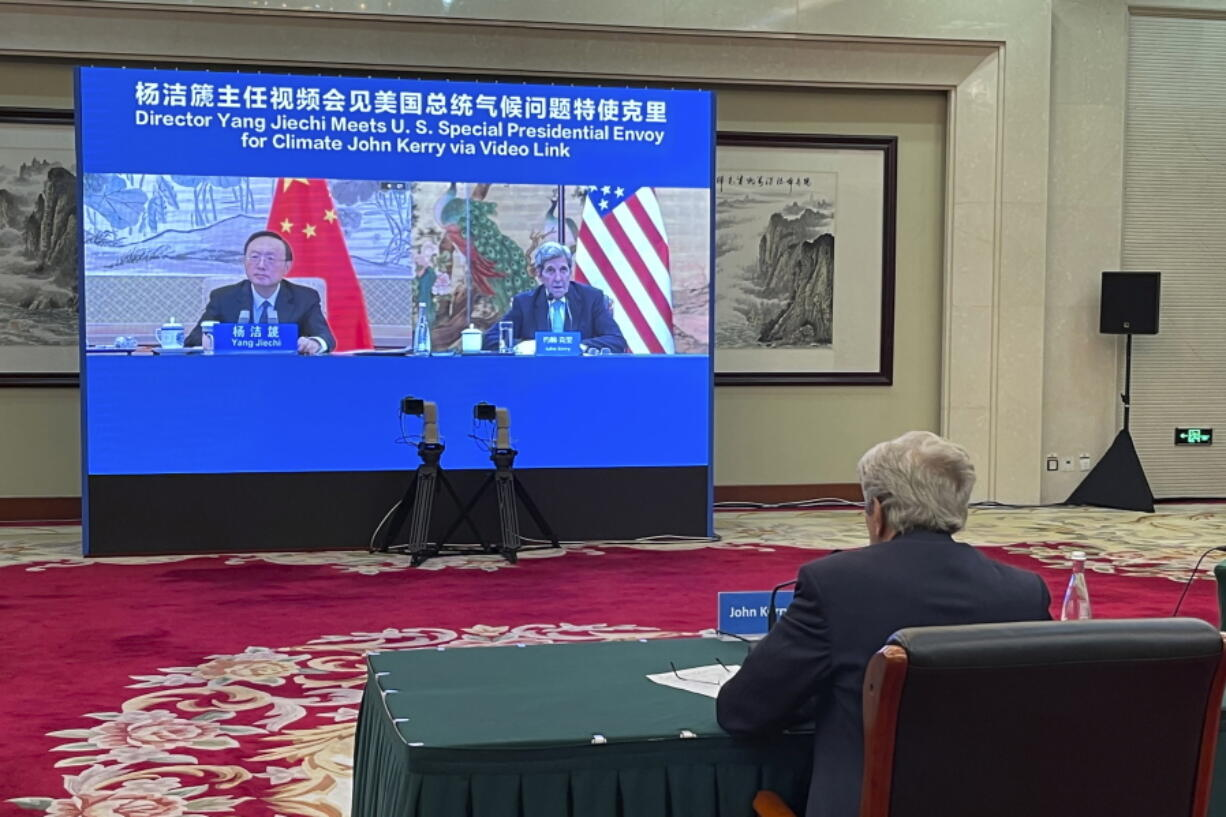 FILE - In this Sept. 2, 2021, file photo provided by the U.S. Department of State, U.S. Special Presidential Envoy for Climate John Kerry attends a meeting with Yang Jiechi, director of China's Office of the Central Commission for Foreign Affairs, via video link in Tianjin, China. Kerry came to China seeking to press the world's largest emitter of greenhouse gases to do more in the global effort to hold down the rise in temperature. What he got was renewed demands for Washington to change its stance toward China on a host of other issues from human rights to Taiwan. (U.S.