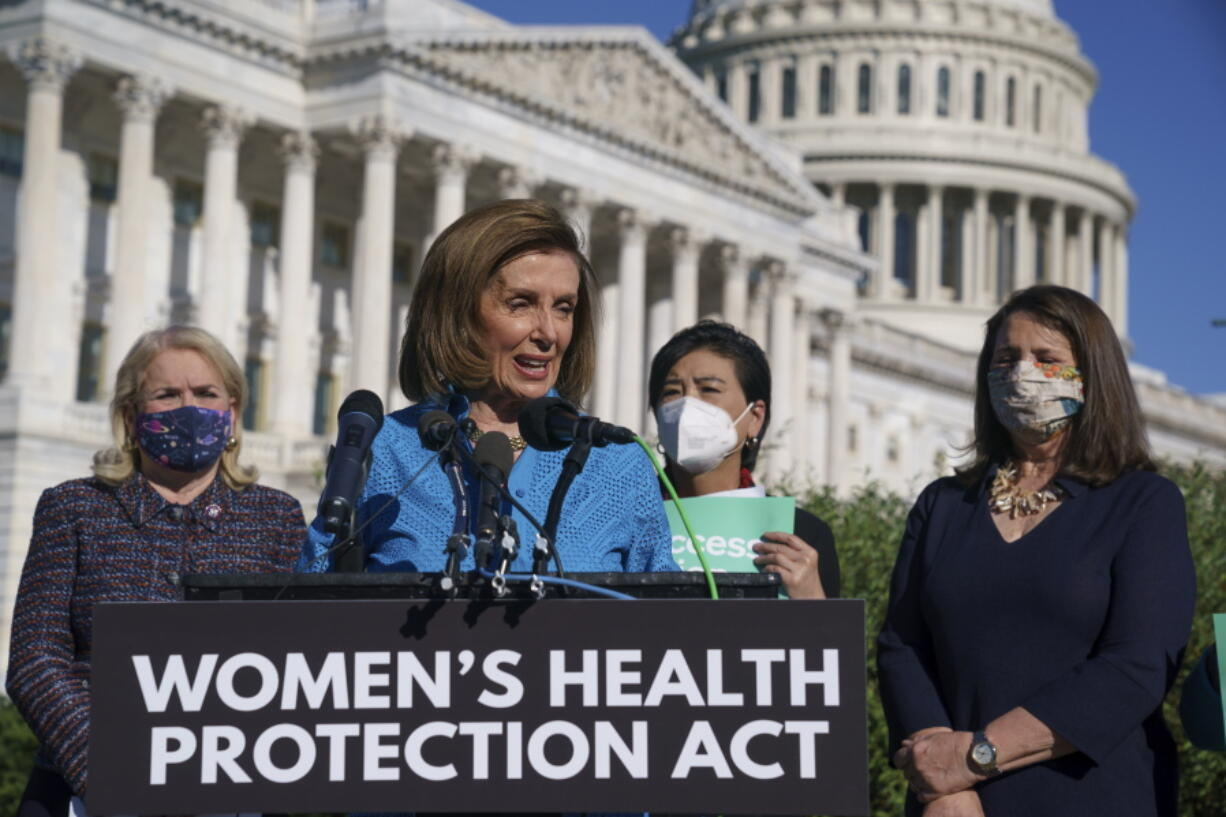 House Speaker Nancy Pelosi, D-Calif., joined from left by Rep. Sylvia Garcia, D-Texas, Rep. Judy Chu, D-Calif., and Rep. Diana DeGette, D-Colo., holds a news conference just before a House vote on legislation aimed at guaranteeing a woman's right to an abortion, an effort by House Democrats to circumvent a new Texas law that has placed that access under threat, at the Capitol in Washington, Friday, Sept. 24, 2021. (AP Photo/J.