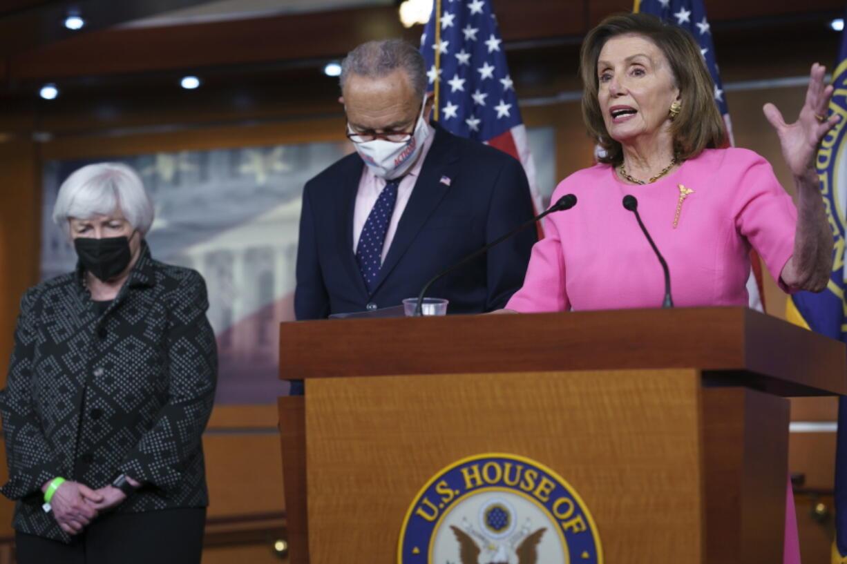 "Speaker of the House Nancy Pelosi, D-Calif., right, Treasury Secretary Janet Yellen, left, and Senate Majority Leader Chuck Schumer, D-N.Y., update reporters on Democratic efforts to pass President Joe Biden's ""Build Back Better"" agenda, at the Capitol in Washington, Thursday, Sept. 23, 2021. (AP Photo/J."