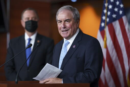 FILE - In this Sept. 21, 2021, file photo House Budget Committee Chair John Yarmuth, D-Ky., joined at left by House Intelligence Committee Chairman Adam Schiff, D-Calif., talks to reporters at the Capitol in Washington. (AP Photo/J.