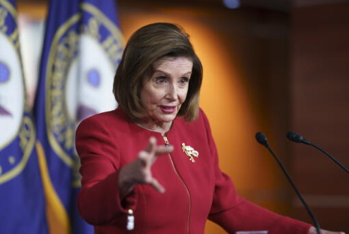 FILE - In this Sept. 8, 2021, file photo speaker of the House Nancy Pelosi, D-Calif., meets with reporters to discuss President Joe Biden's domestic agenda including passing a bipartisan infrastructure bill and pushing through a Democrats-only expansion of the social safety net, the at the Capitol in Washington. (AP Photo/J.