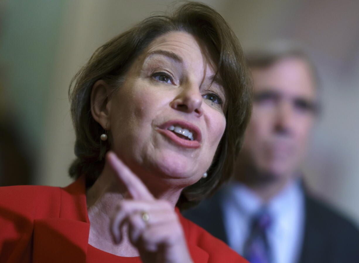 FILE - In this June 22, 2021 file photo, Sen. Amy Klobuchar, D-Minn., talks with reporters at the Capitol in Washington. Senate Democrats unveiled a pared back elections bill Tuesday, Sept. 14, in hopes of kickstarting their stalled push to counteract new laws in Republican states that could make it more difficult to cast a ballot. Klobuchar is the lead sponsor of the new bill. (AP Photo/J.