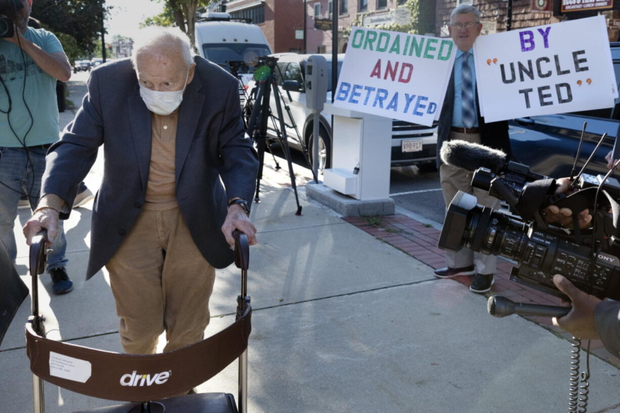 Former Cardinal Theodore McCarrick, left, arrives at Dedham District Court, Friday, Sept. 3, 2021, in Dedham, Mass.  McCarrick, the once-powerful American prelate who was expelled from the priesthood for sexual abuse, pleaded not guilty Friday to sexually assaulting a 16-year-old boy during a wedding reception in Massachusetts nearly 50 years ago.