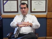 FILE - In this Thursday, July 23, 2020 file photo, Kansas Attorney General Derek Schmidt speaks during an interview in his office in Topeka, Kan. Schmidt, first elected in 2010, is running for Kansas governor in 2022.
