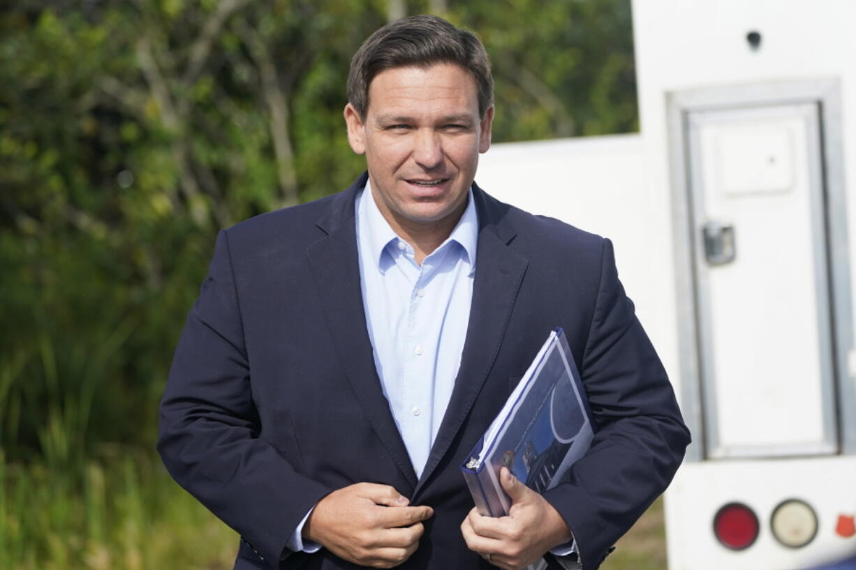 FILE - In this Tuesday, Aug. 3, 2021, file photo, Florida Gov. Ron DeSantis arrives at a news conference, near the Shark Valley Visitor Center in Miami. On Sunday, Sept. 12, three Republican presidential prospects, including DeSantis, sharply condemned President Joe Biden's handling of the end of the war in Afghanistan, rebuking the administration's conduct of the U.S. withdrawal as weak and as emboldening its adversaries.