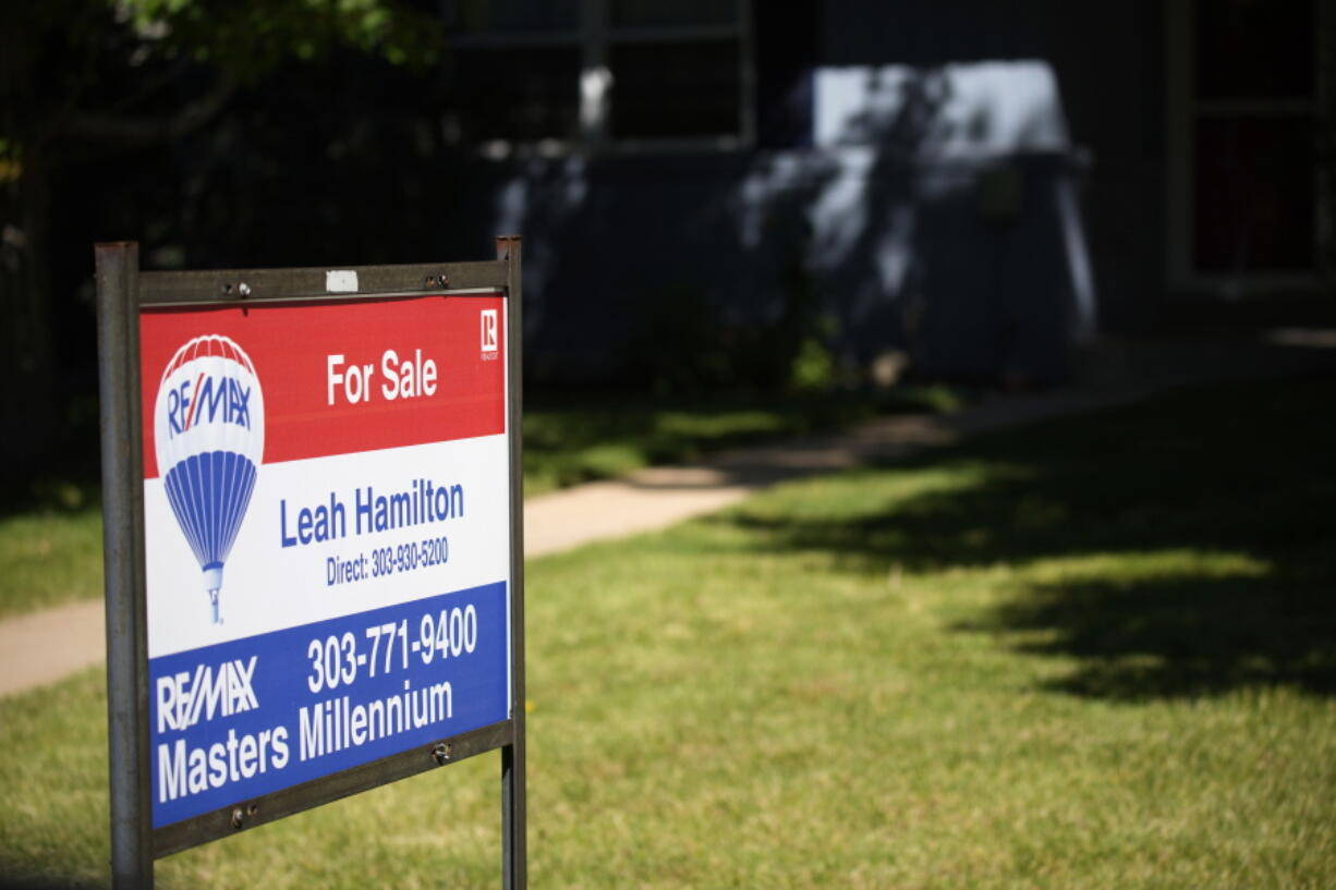 A sale sign stands outside a home on the market Tuesday, Sept. 21, 2021, in southeast Denver. The National Association of Realtors releases existing home sales for August on Wednesday, Sept. 22.