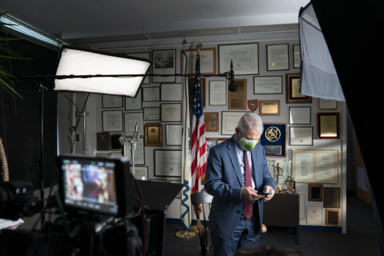 """This image released by National Geographic shows Dr. Anthony Fauci at the NIH in Bethesda, Md., during the filming of the documentary """"Fauci."""" John Hoffman and Janet Tobias's portrait of the director of the National Institute of Allergy and Infectious Diseases will screen only in theaters mandating vaccination and masking."""