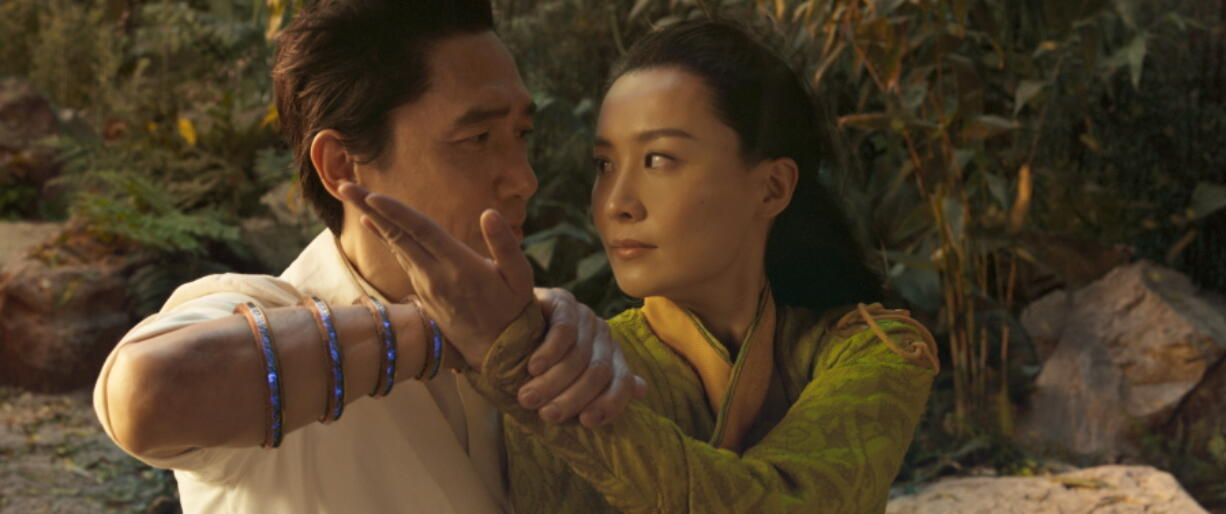 """Tony Leung, left, and Fala Chen in a scene from """"Shang-Chi and the Legend of the Ten Rings."""" (Marvel Studios)"""