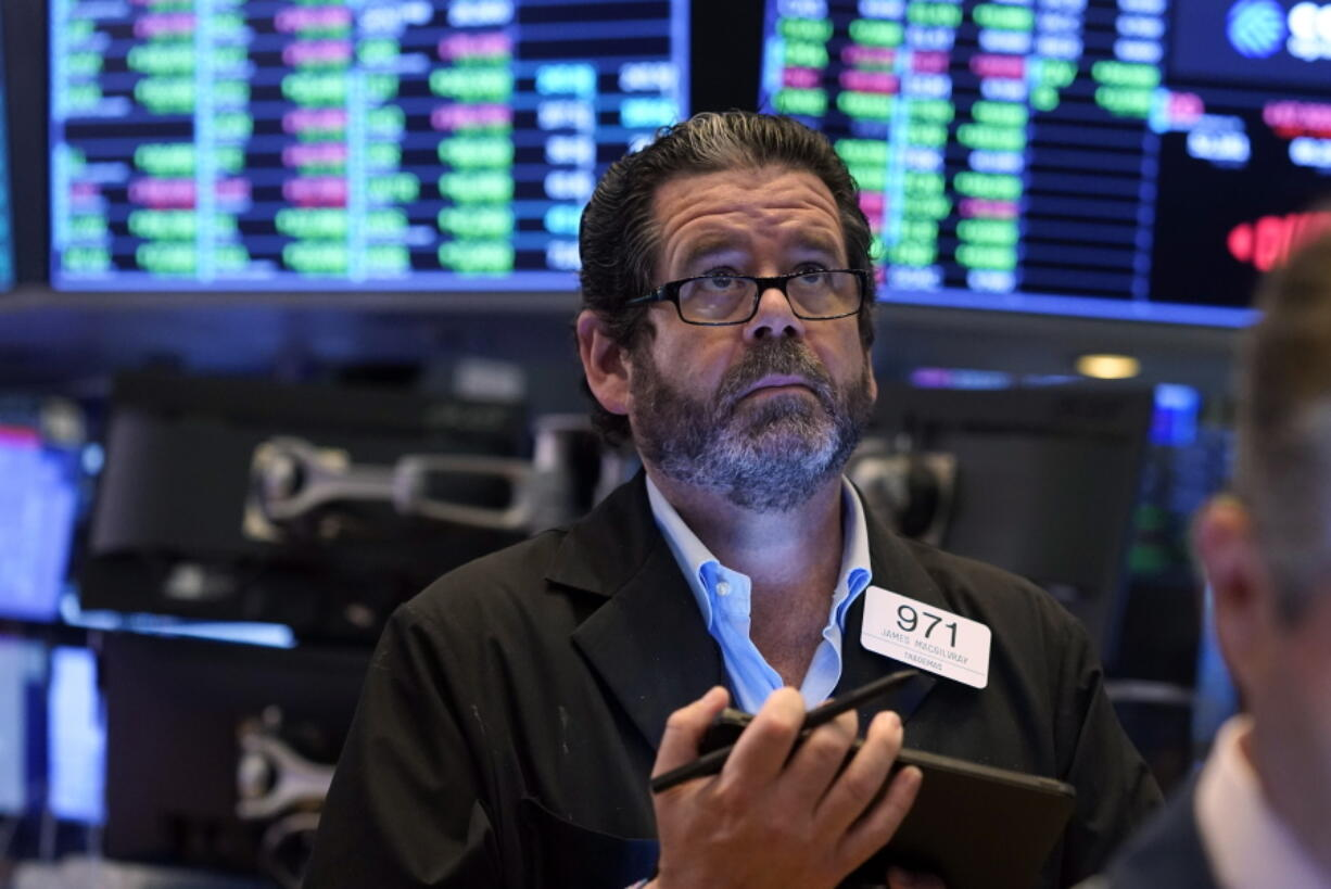 Trader James Macgilvray works on the floor of the New York Stock Exchange, Tuesday, Sept. 21, 2021. Stocks are opening modestly higher on Wall Street, making up some of the ground they lost in a sharp pullback a day earlier.