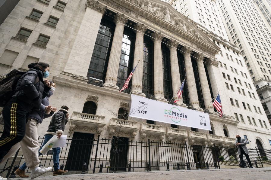 FILE - In this Jan. 27, 2021 file photo, pedestrians pass the New York Stock Exchange, in New York. Stocks were off to a mixed start on Wall Street Thursday, Sept. 16,  as gains for retailers are offset by drops in technology and materials companies.