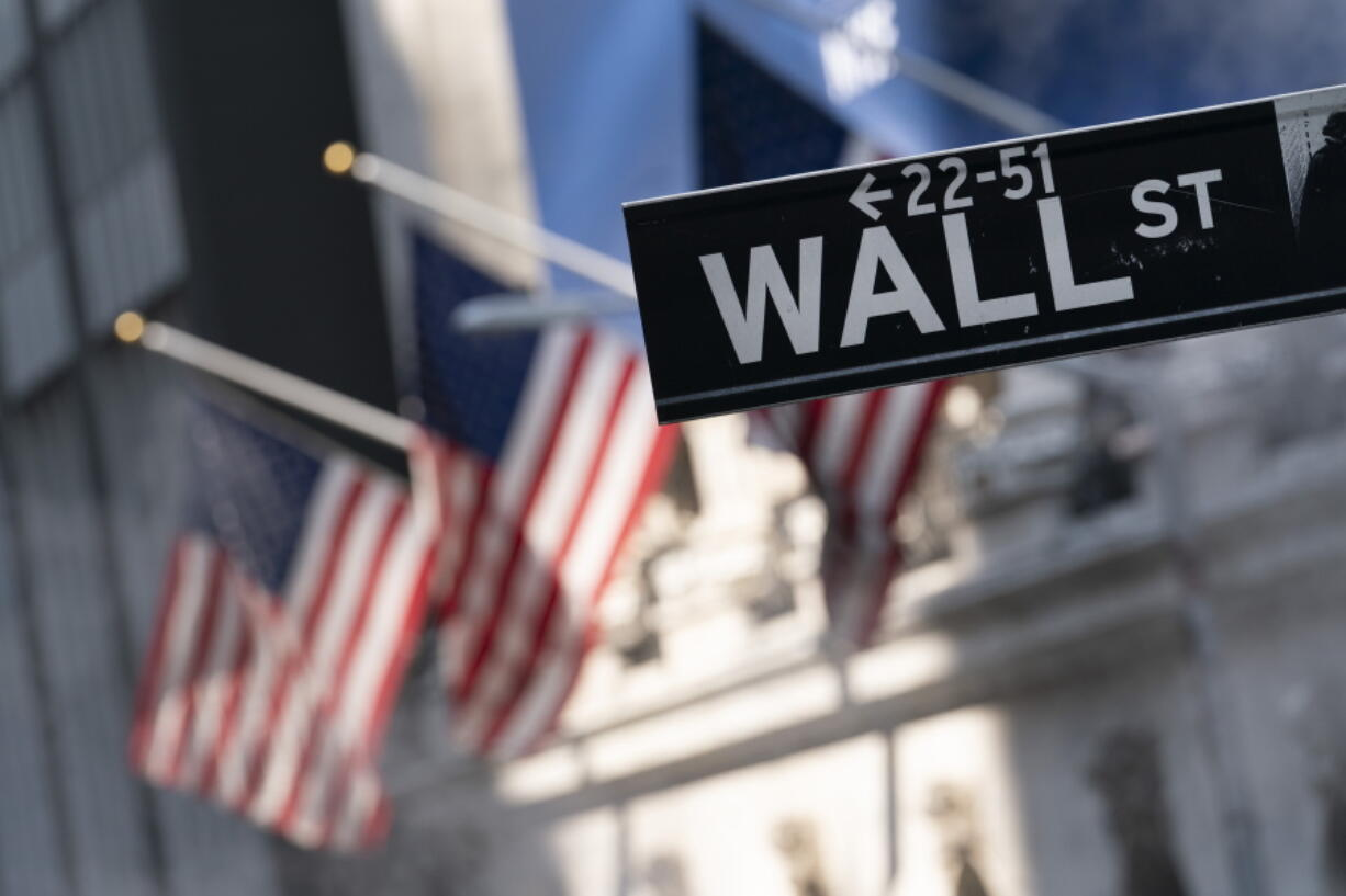 FILE -A sign for Wall Street hangs in front of the New York Stock Exchange, July 8, 2021.  Stocks are off to a mostly lower start on Wall Street Friday, Sept. 17,  as the market heads for a weak ending to an up-and-down week of trading.