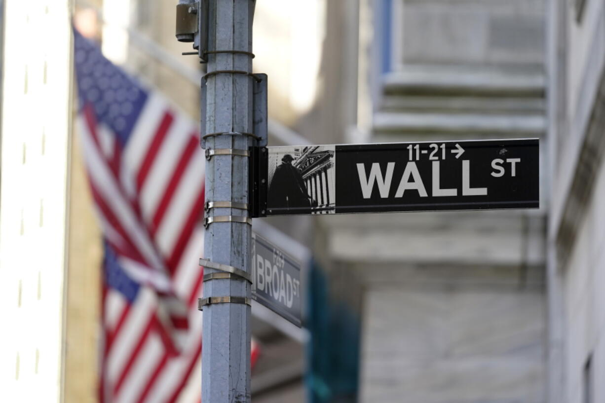 FILE - In this June 16, 2021 file photo, flags adorn the facade of the New York Stock Exchange.  Stocks are opening mostly lower on Wall Street, Wednesday, Sept. 8,  with technology companies leading the way lower, a reversal of the gains they posted a day earlier.