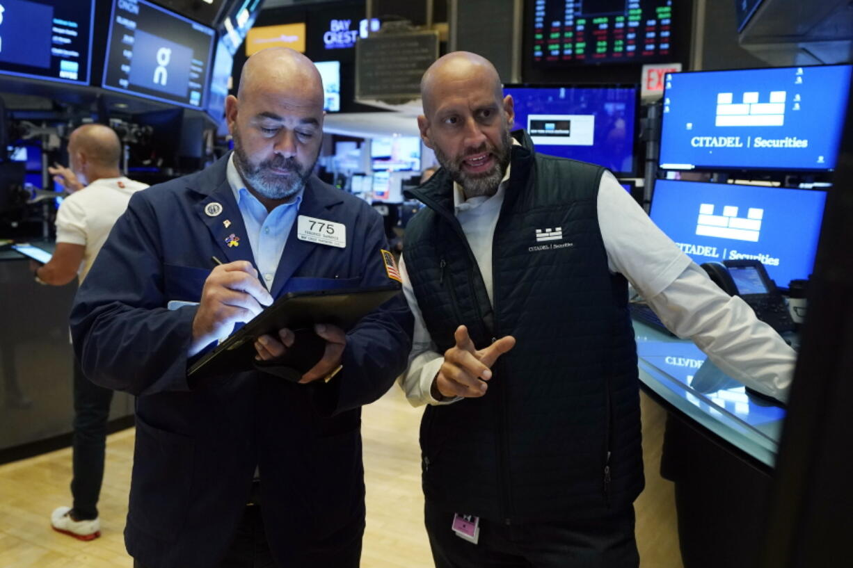 Trader Fred DeMarco, left, and specialist Meric Greenbaum work on the floor of the New York Stock Exchange, Wednesday, Sept. 15, 2021. Stocks were modestly higher in morning trading Wednesday, helped by higher energy prices which in turn pushed energy companies higher.
