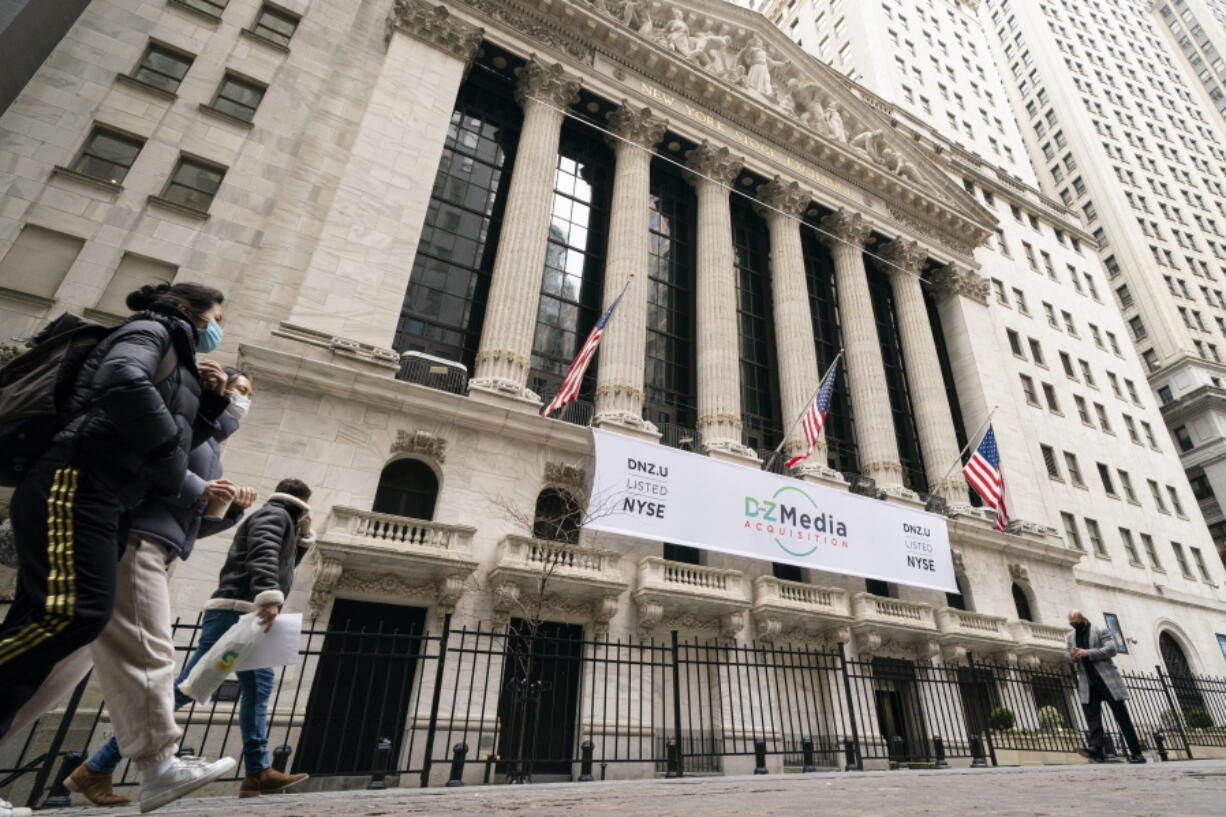 FILE - In this Jan. 27, 2021 file photo, pedestrians pass the New York Stock Exchange, in New York.  Stocks are off to a weak start on Wall Street Friday, Sept. 24, losing momentum after a two-day rally.