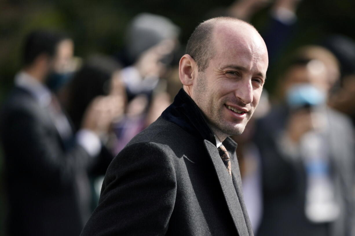 FILE - In this Oct. 30, 2020, file photo, then-President Donald Trump's White House senior adviser Stephen Miller walks on the South Lawn of the White House in Washington. Tens of thousands of Afghan refugees fleeing the Taliban are arriving in the U.S., and a handful of former Trump administration officials are working to turn Republicans against them.