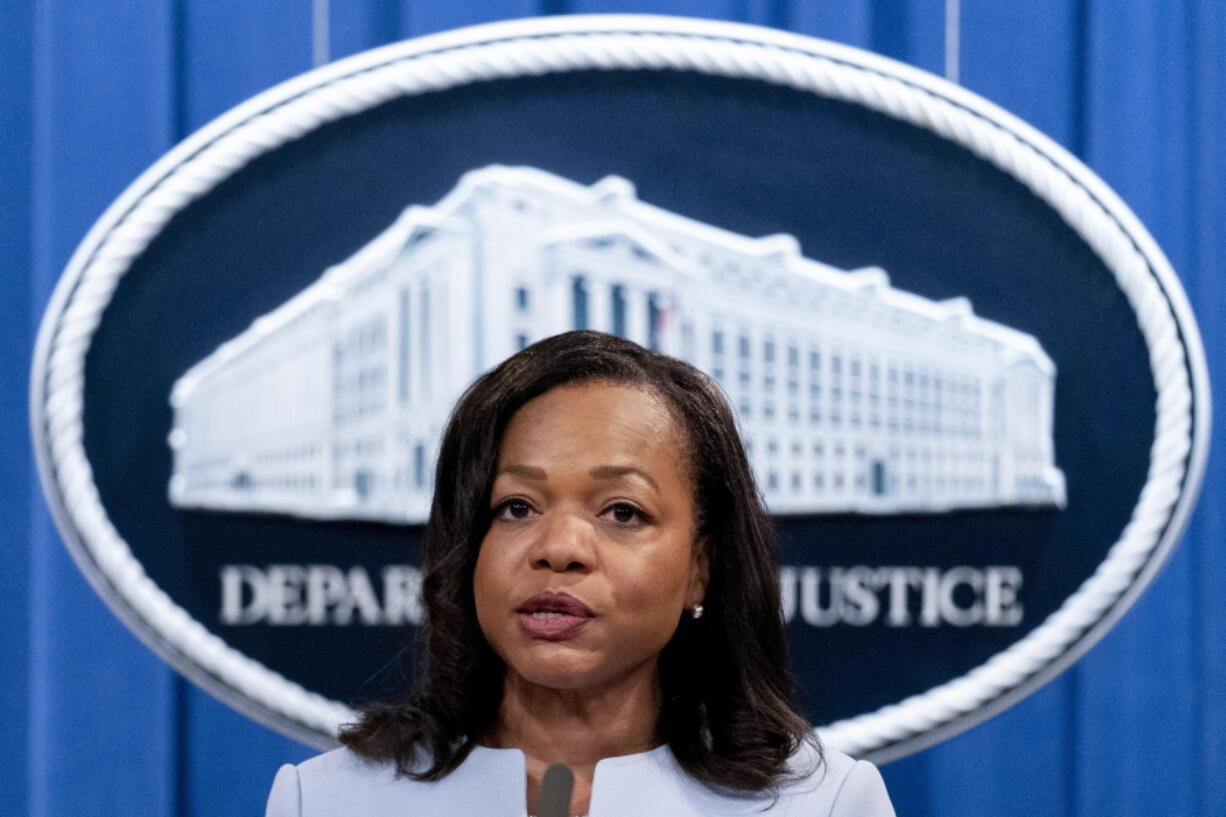 FILE - In this Aug. 5, 2021 file photo, Assistant Attorney General for Civil Rights Kristen Clarke speaks at a news conference at the Department of Justice in Washington.  The U.S. Department of Justice on Tuesday announced a statewide civil rights investigation into Georgia prisons.