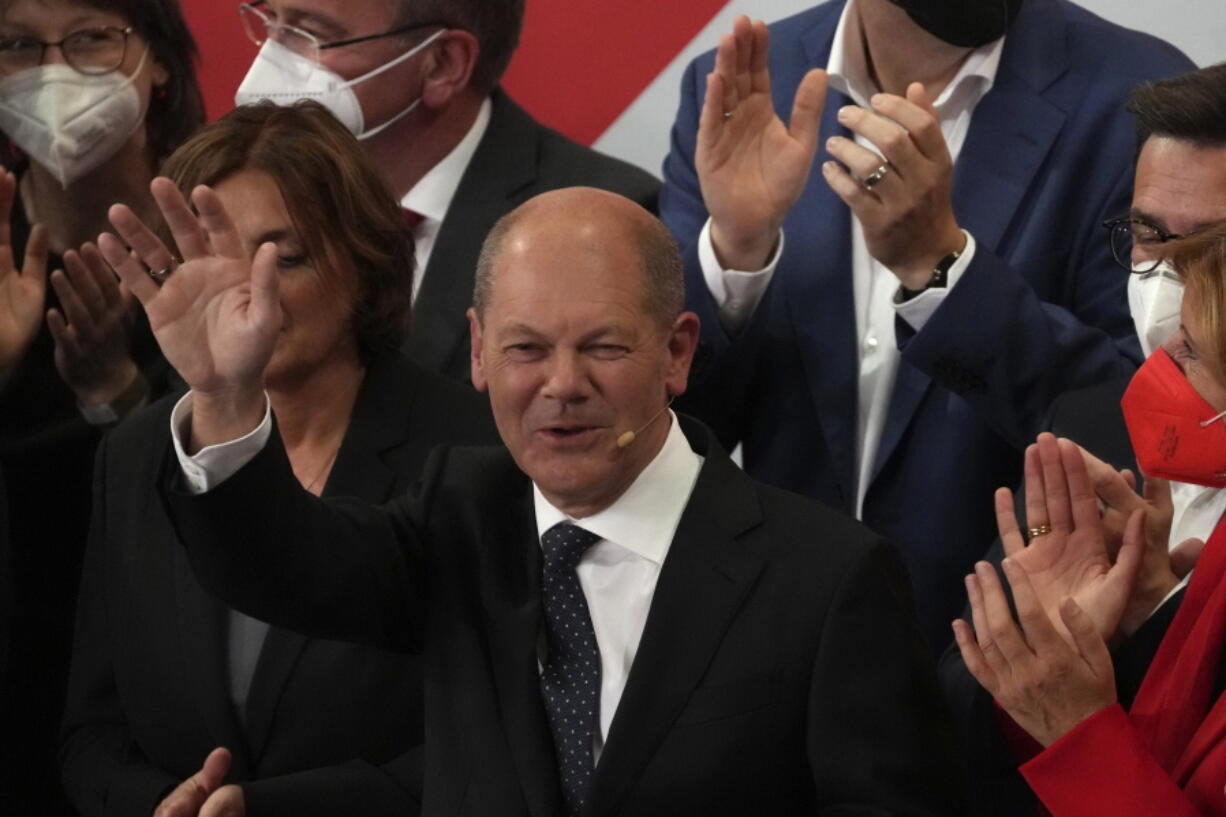 Olaf Scholz, Finance Minister and SPD candidate for Chancellor waves to his supporters after German parliament election at the Social Democratic Party, SPD, headquarters in Berlin, Sunday, Sept. 26, 2021.