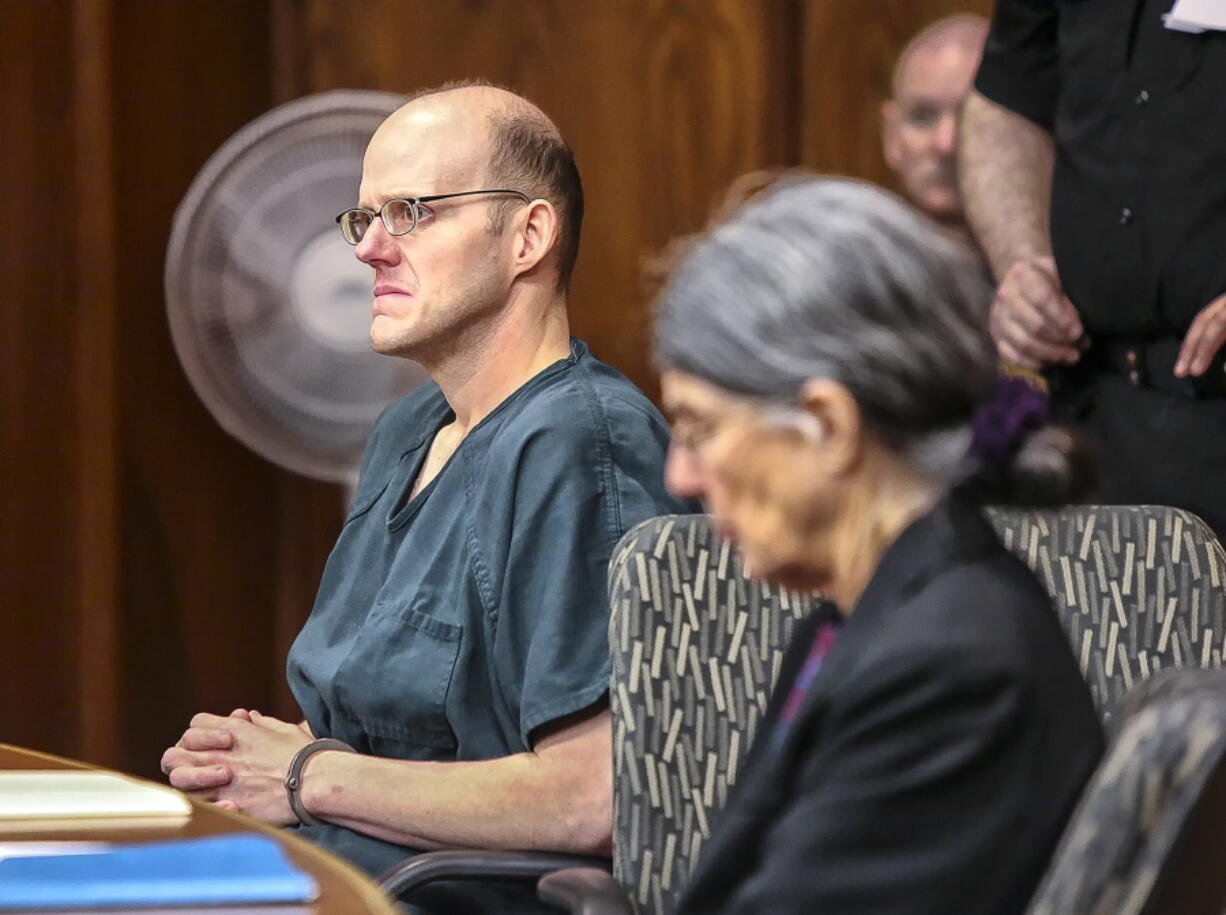 Timothy Haag listens as his attorney gives her opening remarks in Cowlitz County Superior Court in Longview on Jan. 12, 2018.