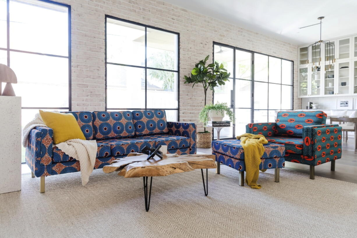 This photo provided by Albany Park shows the Ekaabo seating collection. Albany Park's founder Darryl Sharpton drew on his Nigerian heritage to create his Ekaabo seating collection. The name means 'welcome home', and the velvet upholstery's dynamic blue, orange and burgundy graphics echo West African design.