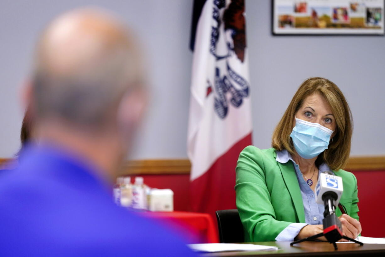 In this Sept. 2, 2021, photo Rep. Cindy Axne, D-Iowa, speaks about the Rural Reinvestment Task Force during a meeting with local officials in Indianola, Iowa.