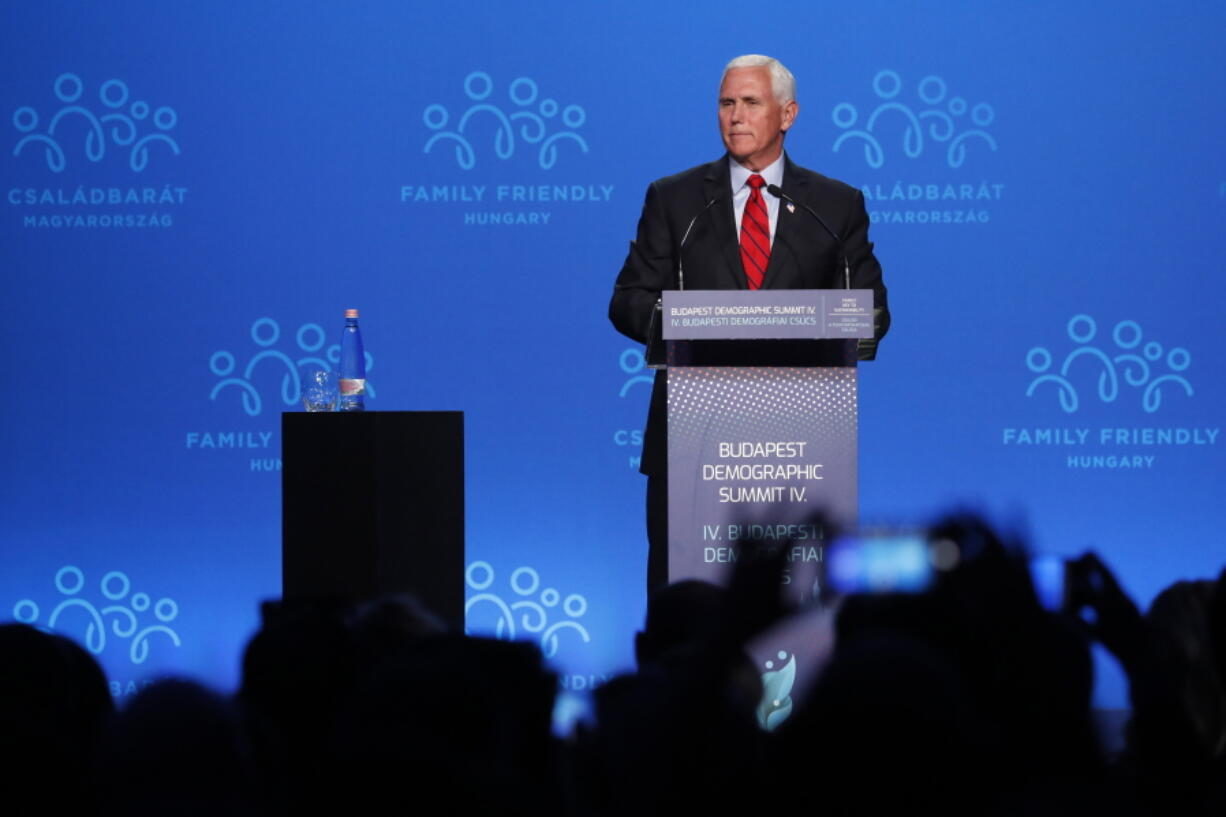 """Former US Vice President Mike Pence holds a speech during the 4th Budapest Demographic Summit in Budapest, Hungary, Thursday, Sept. 23, 2021. The biannual demographic summit, which was first organized in 2015, offers a forum for """"pro-family thinker"""" decision-makers, scientists, researchers, and church representatives of the same sort to exchange their thoughts about connections between demographics and sustainability."""